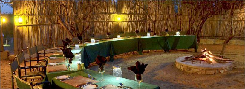 Greenfire Lodge, dining at the end of a gameviewing day, in the traditional boma
